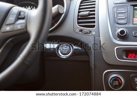 Dashboard of the car with the engine startup button - stock photo