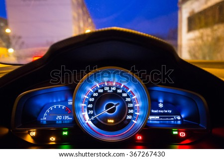 Dashboard of the sport car at night - stock photo