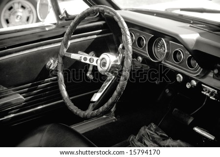 dashboard of vintage american seventies car in black and white