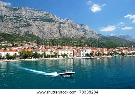 dashing motorboat on makarska riviera, croatia - stock photo