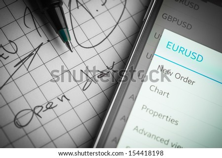 Data analyzing in forex market: the charts and quotes on smartphone display. Analytics  pair U.S. dollar \ Euro.  - stock photo
