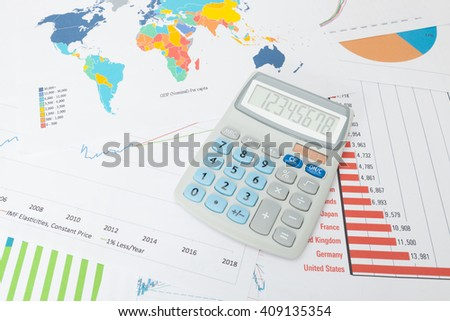 Data charts with calculator over it - stock photo