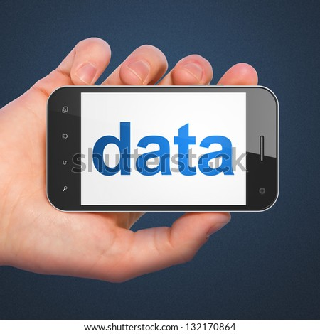 Data concept: hand holding smartphone with word Data on display. Generic mobile smart phone in hand on Dark Blue background. - stock photo