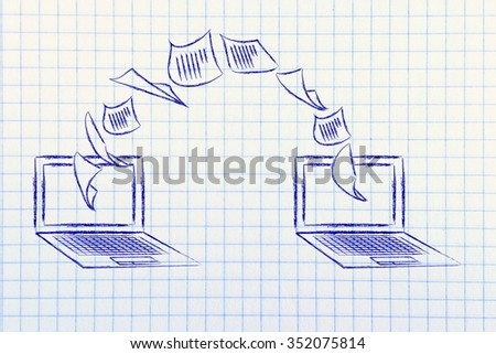 data exchange and intranet concept: laptops with documents flying from one screen to the other - stock photo
