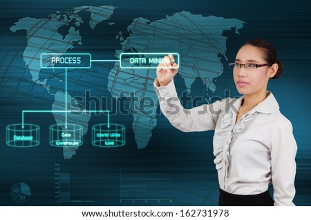 Data mining concept - business woman show virtual screen - stock photo