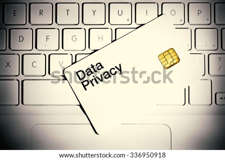 Data Privacy concept. Smart card on the white laptop computer. - stock photo