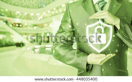 Data protection and insurance. Concept of business security, safety of information from virus, crime and attack. Internet secure system. Blurred mall background. - stock photo