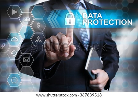 Data protection concept. Businessman pointing on virtual screen with text and icons. - stock photo
