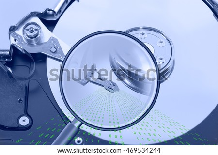 data search concept with opened hard drive disk and magnifying glass