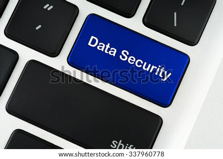 Data security text on blue keyboard button - privacy concept - stock photo