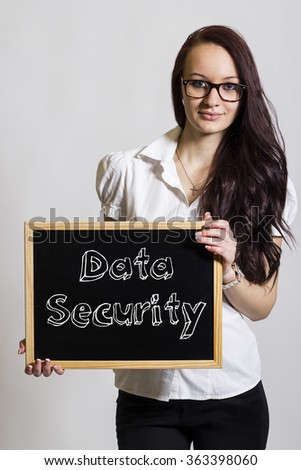 Data Security - Young businesswoman holding chalkboard - vertical image - stock photo