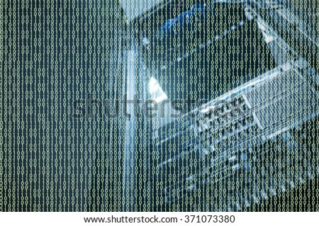 Data storage overlay on rack server against neon light flare in datacenter with dept of field - stock photo