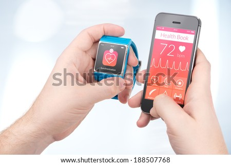 Data synchronization of health book between smartwatch and smartphone in male hands - stock photo