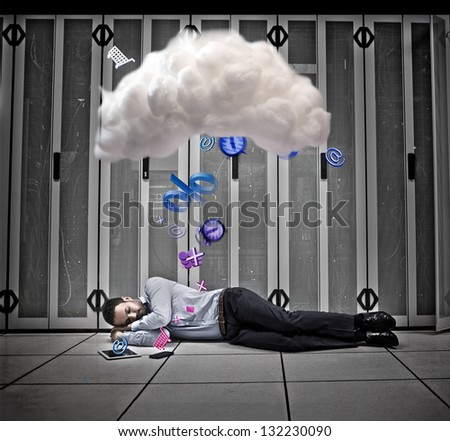 Data worker dreaming of applications and cloud computing on floor of data centre - stock photo