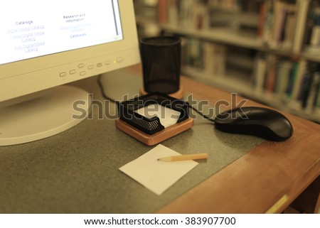 Database and books in library.  - stock photo