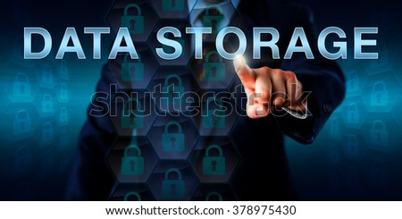 Database manager is pushing DATA STORAGE on a touch screen interface. Technology and business concept. Many locked padlock icons embedded in a hexagonal structure do represent reliable data storage. - stock photo
