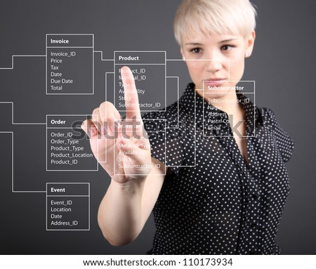 Database Table - technical concept, girl pointing screen - stock photo