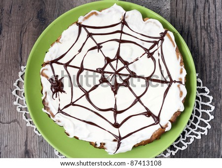 Date and chocolate cake with Halloween decoration - spider web - stock photo