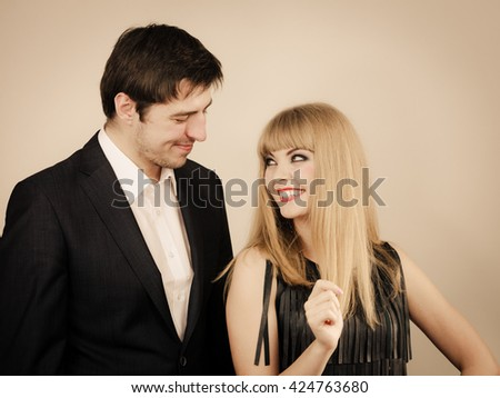 Date flirt and love concept. Valentine's Day. Attractive blonde woman with handsome man dating. Elegant glamorous couple pare fall in love. - stock photo