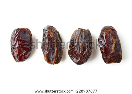 Date fruits isolated on white