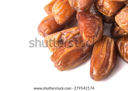 Date fruits over white background - stock photo