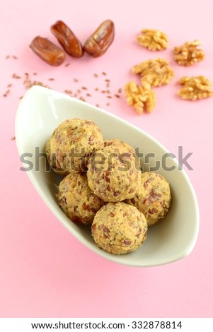 Date Walnut Flax Seed Energy Balls in a Bowl