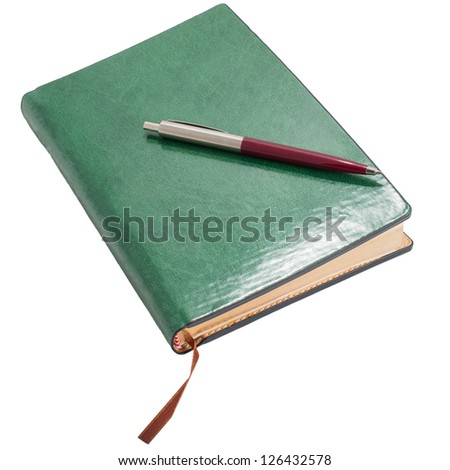 Datebook with pen isolated on white - stock photo