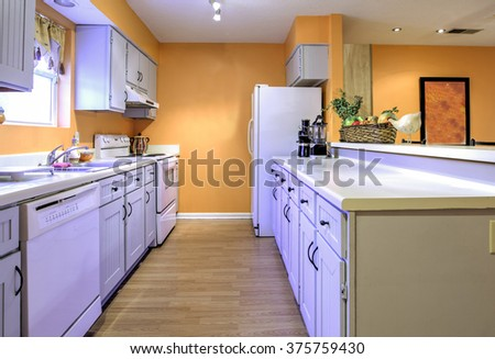 Dated kitchen in need of remodel, galley style kitchen - stock photo