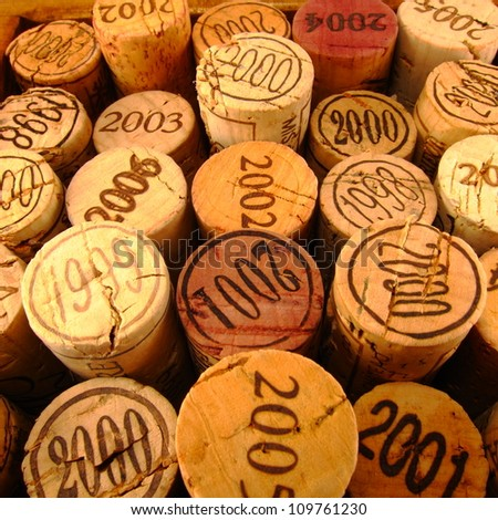 Dated Wine Bottle Corks with Staggered Heights. View 1. - stock photo