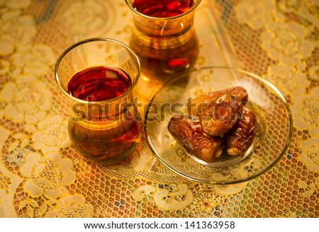 Dates and black tea - stock photo