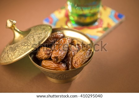 Dates and pure drinking water is consume to end Ramadan fast. Breaking Ramadan fast at Iftar. - stock photo