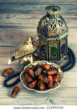 Dates, arabic lantern and rosary. Oriental decoration. Retro style toned picture - stock photo