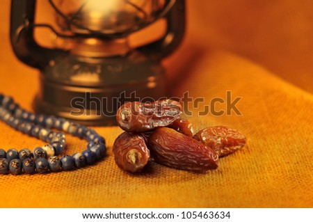 Dates,lantern and rosary still life - stock photo