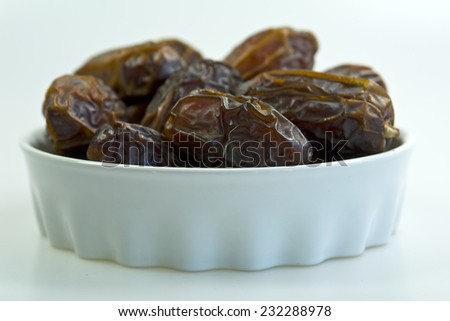 Dates on white bowl