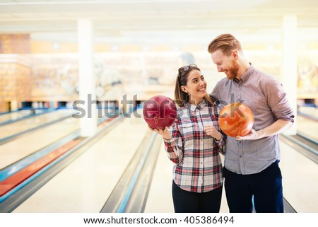 Dating couple enjoy bowling together - stock photo