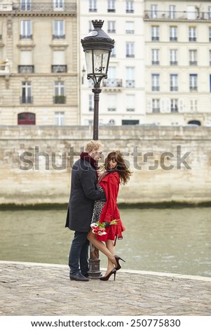 Dating couple in Paris, near the Seine - stock photo