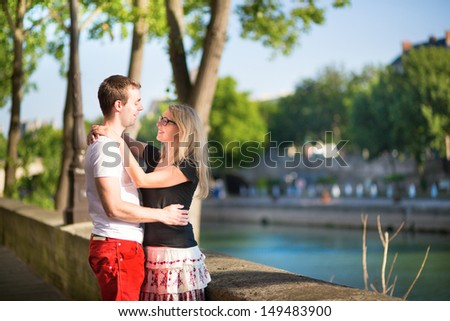 Dating couple in Paris on a summer day - stock photo