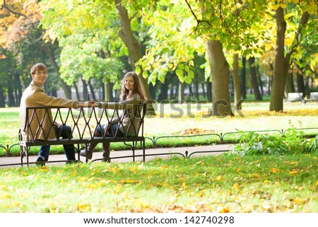 Dating couple in park - stock photo