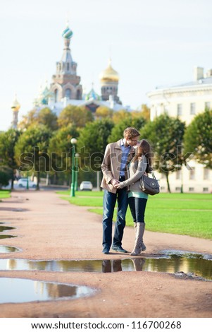 Dating couple near Church of the Savior on Blood in Saint-Petersburg, Russia - stock photo