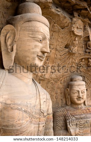 DATONG, CHINA - SEPTEMBER 9, 2011: Statues in the Yungang caves in Datong on September 9, 2011.  These ancient Buddhist temple grottoes (5th and 6th century) are composed of more than 51,000 statues