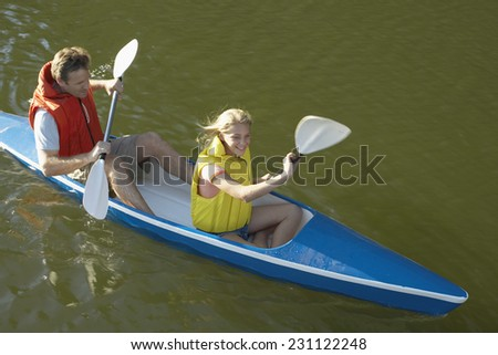 Daughter and Father Going Kayaking in Lake - stock photo