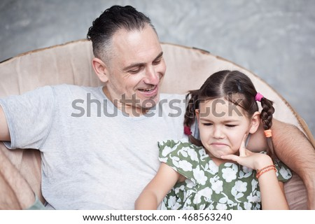Daughter and father talking together