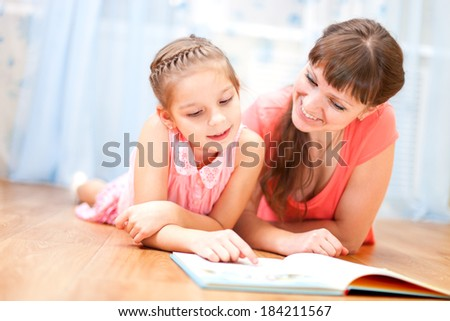 Daughter and mom read the book together.