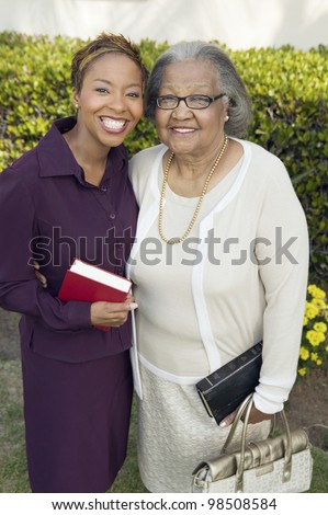 Daughter and Mother Going to Church - stock photo