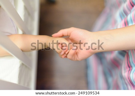 daughter and mother holding hands