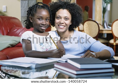 Daughter and mother learning together
