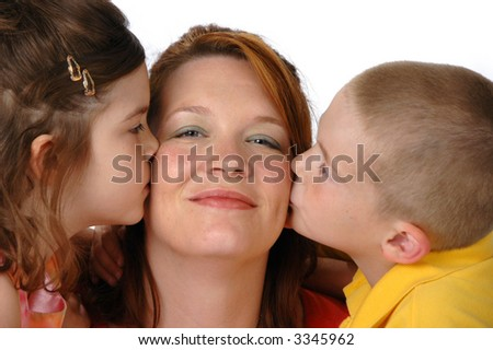 Daughter and son kissing mom against a white background