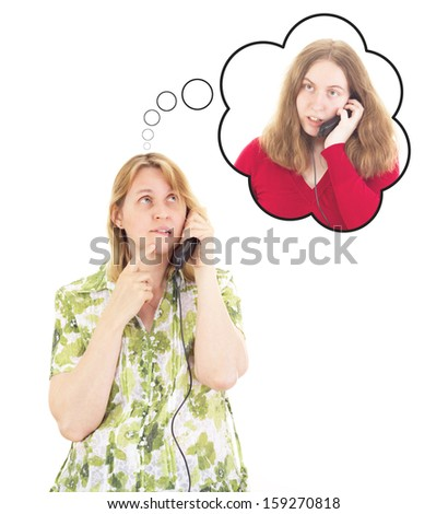 Daughter calling worried mother - stock photo