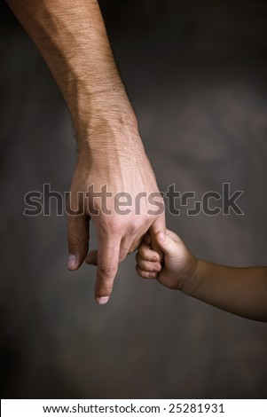 Daughter holds the hand of the father