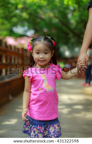 Daughter holds the hands of the mother - stock photo